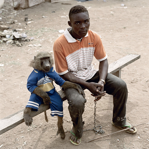 Dayaba Usman with the monkey Clear, Nigeria, 2005From the series